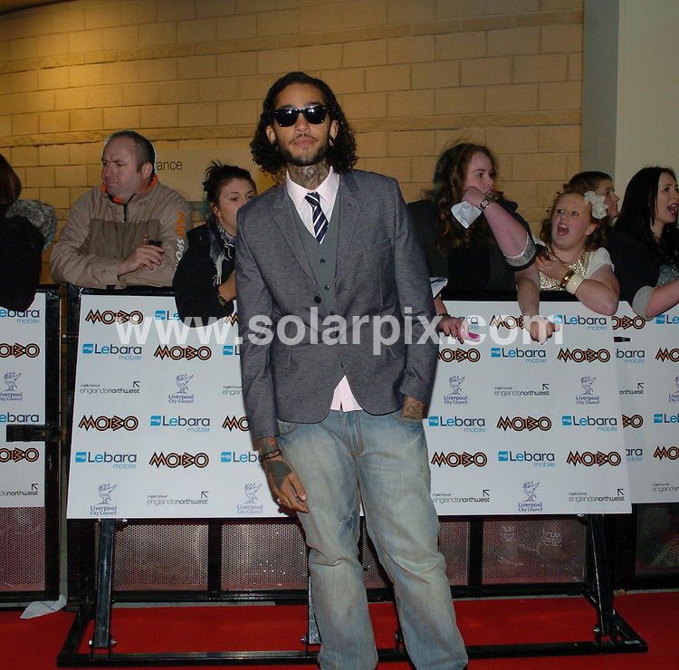 **ALL ROUND PICTURES FROM SOLARPIX.COM**                                             **WORLDWIDE SYNDICATION RIGHTS**                                                                                  Caption:  Mobo Awards 2010, Liverpool Arena, UK, 20 October 2010                                                                             This pic:  Travie McCoy                                                                    JOB REF: 12352        SGD       DATE: 20_10_10                                                           **MUST CREDIT SOLARPIX.COM OR DOUBLE FEE WILL BE CHARGED**                                                                      **MUST AGREE FEE BEFORE ONLINE USAGE**                               **CALL US ON: +34 952 811 768 or LOW RATE FROM UK 0844 617 7637**