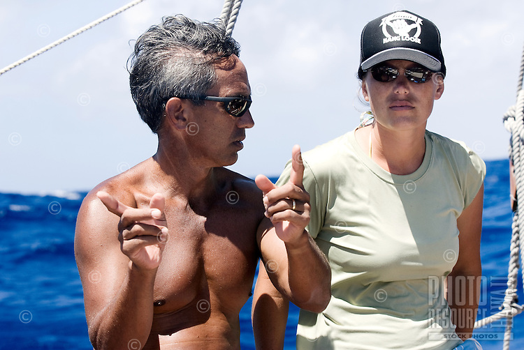 Ka'iulani Murphy learns navigation from Nainoa Thompson aboard Polynesian voyaging canoe, Hokule'a _.Voyage to Micronesia; .March 22, 2007