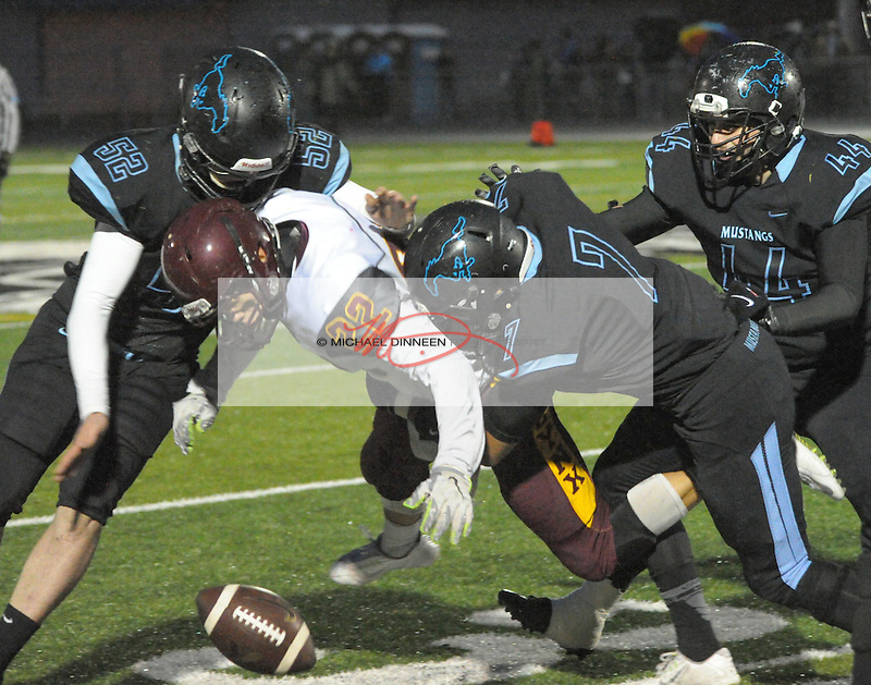DImond's Cicano Zavala is stripped of the ball on the game's second play by Chugiak's Camden Lerch (52), TDevin Cormier (7) and Noah Harris (44)