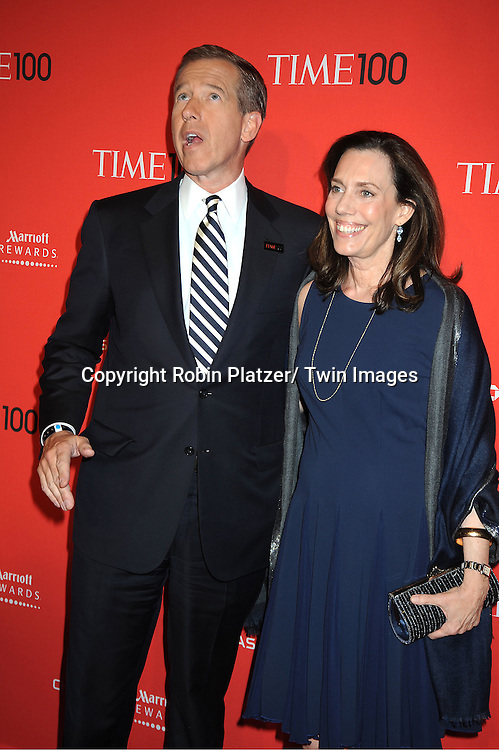Brian Williams and wife attends The Time 100 Most Influential People in the World Gala on April 24, 2012 at Frederick P Rose Hall at Lincoln Center in New York City. .