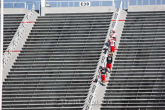 Salt Lake City - Salt Lake City - at University of Utah college football practice Thursday March 12, 2009 at Rice-Eccles Stadium. players walking stairs.