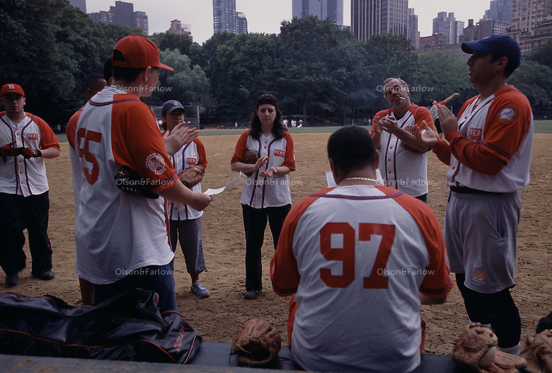 Softball teams meet in Central Park.  Frederick Law Olmsted who designed that park wouldn't have approved of such sporting events in his plans.