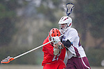 Los Angeles, CA 03/23/11 - Nate Schuler (Illinois #19) and Thomas Anderson (LMU #21) in action during the Illinois-LMU non conference MCLA game at Loyola Marymount University.