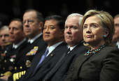 West Point, NY - December 1, 2009 -- United States Secretary of State Hillary Rodham Clinton, U.S. Secretary of Defense Robert Gates, Secretary of Veterans Affairs Gen. Eric Shinseki , Chairman of the Joint Chiefs of Staff Admiral Michael Mullen and Admiral David Petraeus (R to L) look on as  U.S. President Barack Obama speaks about his decision to increase U.S. troop levels in Afghanistan by about 30,000 during a speech at the U.S. Military Academy at West Point, New York, on Tuesday, December 1, 2009. The buildup is targeted to reverse the Taliban advances in the country and to train Afghan soldiers and police.  .Credit: Roger L. Wollenberg - Pool via CNP