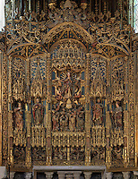 Detail of the main altarpiece in the main chapel, in the Old Cathedral of Coimbra, or Se Velha de Coimbra, a 12th century Romanesque Roman Catholic cathedral in Coimbra, Portugal. The altarpiece, 1503, is of gilded and polychrome wood in Gothic style, was commissioned by Bishop Jorge de Almeida and made by the Flemish masters Olivier de Gante and Jean d'Ypres. The cathedral was designed by Master Robert, a French architect, with the works overseen by Master Bernard and Master Soeiro. It was reworked in the 16th century, with the addition of tiled decoration, a portal and Renaissance chapel. The city of Coimbra dates back to Roman times and was the capital of Portugal from 1131 to 1255. Its historic buildings are listed as a UNESCO World Heritage Site. Picture by Manuel Cohen