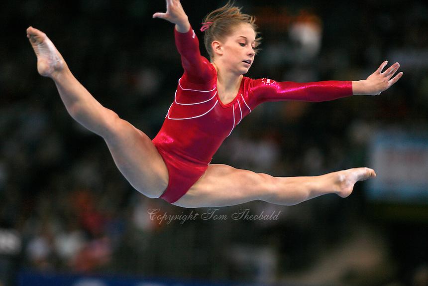 floor gymnastics shawn johnson. September 9, 2007; Stuttgart, Germany; Shawn Johnson Of USA Straddle Jumps On Floor Gymnastics W