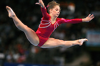 September 9, 2007; Stuttgart, Germany;  Shawn Johnson of USA straddle jumps on floor exercise during event finals in women's artistic gymnastics at 2007 World Championships.  Photo by Copyright 2007 by Tom Theobald.