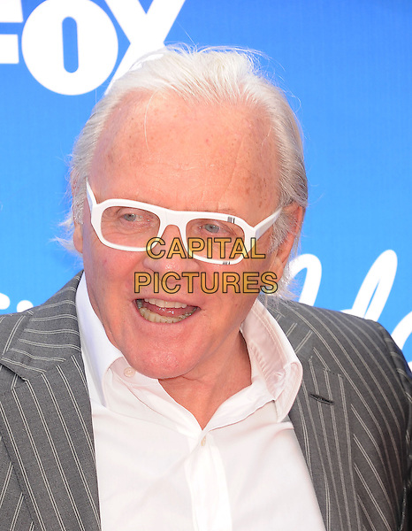 "Sir Anthony Hopkins.arriving at FOX's ""American Idol"" Grand Finale at Nokia Theatre L.A. Live in Los Angeles, California, USA,.May 16th 2013..portrait headshot white frames glasses shirt grey gray pinstripe striped jacket mouth open .CAP/ROT/TM.©Tony Michaels/Roth Stock/Capital Pictures"