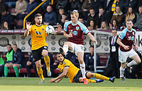 Burnley's Chris Wood vies for possession with  Wolverhampton Wanderers' Ruben Neves<br /> <br /> Photographer Rich Linley/CameraSport<br /> <br /> The Premier League - Burnley v Wolverhampton Wanderers - Saturday 30th March 2019 - Turf Moor - Burnley<br /> <br /> World Copyright © 2019 CameraSport. All rights reserved. 43 Linden Ave. Countesthorpe. Leicester. England. LE8 5PG - Tel: +44 (0) 116 277 4147 - admin@camerasport.com - www.camerasport.com