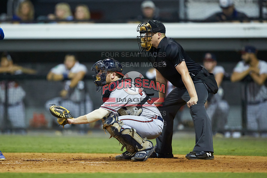 Danville Braves catcher Mitch Calandra (37) sets a target as home plate umpire West Hyer looks on during the game against the Burlington Royals at Burlington Athletic Stadium on August 9, 2019 in Burlington, North Carolina. The Royals defeated the Braves 6-0. (Brian Westerholt/Four Seam Images)