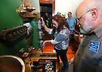 Coiner Ken Hopple watches Nina Laxalt mint a medallion of the fourth and final in a commemorative Sesquicentennial series at the Nevada State Museum, in Carson City, Nev., on Wednesday, Sept. 3, 2014. <br /> Photo by Cathleen Allison
