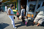 Ljatife Sikovska (left) is director of Ambrela, a grassroots Roma women's organization in Suto Orizari, the Macedonian municipality that is Europe's largest Roma settlement. Here she talks with a woman on the street in Suto Orizari about the woman's lack of sufficient legal documents, a common headache for Roma in Macedonia.