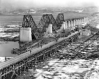 """Freedom Gate Bridge"" spanning the Imjin River, built by the 84th Engineer Construction Bn.  This bridge temporarily replaces the original structure which was destroyed by bombs.  March 10, 1952.  G. Dimitri Boria. (Army)<br /> NARA FILE #:  111-SC-410709<br /> WAR & CONFLICT BOOK #:  1407"
