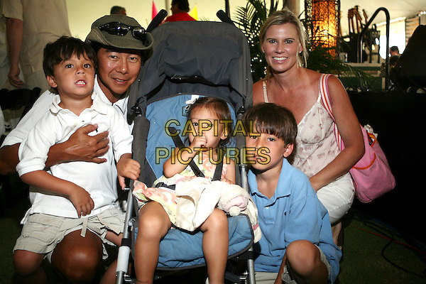HENRY CHO & family.The 15th Annual Vinny Golf Tournament, Nashville, Tennessee, USA,.12,13 August, 2007..half length sitting children kids.CAP/ADM/RR.©Randi Radcliff/AdMedia/Capital Pictures.