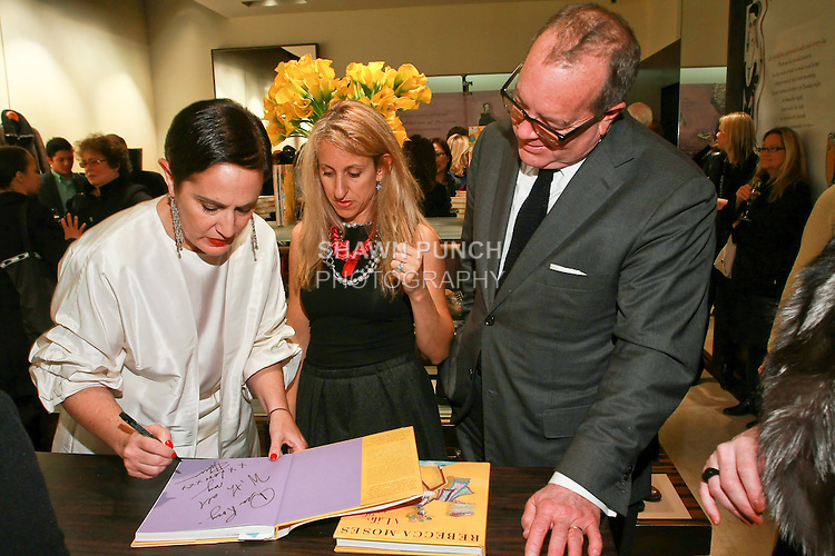 "Rebecca Moses signs book for Ronald and Georgia Frasch at the Rebecca Moses ""A Life of Style"" book signing at Fratelli Rossetti Boutique, November 11, 2010."