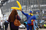 A man dressed as Bananaman sells inflatable bananas during the Barclays Premier League match at Old Trafford. Photo credit should read: Philip Oldham/Sportimage