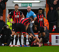 Referee Lee Mason oversees the treatment of Bournemouth's Steve Cook<br /> <br /> Photographer David Horton/CameraSport<br /> <br /> The Premier League - Bournemouth v Liverpool - Saturday 8th December 2018 - Vitality Stadium - Bournemouth<br /> <br /> World Copyright © 2018 CameraSport. All rights reserved. 43 Linden Ave. Countesthorpe. Leicester. England. LE8 5PG - Tel: +44 (0) 116 277 4147 - admin@camerasport.com - www.camerasport.com