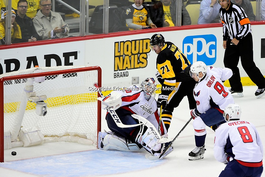 May 8, 2017: Pittsburgh Penguins center Evgeni Malkin (71) scores against Washington Capitals goalie Braden Holtby (70)  late in the third period during game 6 of the second round of the National Hockey League Eastern Conference Stanley Cup Playoffs between the Washington Capitals and the Pittsburgh Penguins, held at PPG Paints Arena, in Pittsburgh, PA. Washington defeats Pittsburgh 5-2 to tie the best of seven series 3-3. Eric Canha/CSM