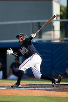 Carlos Martinez (8) of the Danville Braves follows through on his swing against the Pulaski Yankees at American Legion Post 325 Field on July 31, 2016 in Danville, Virginia.  The Yankees defeated the Braves 8-3.  (Brian Westerholt/Four Seam Images)