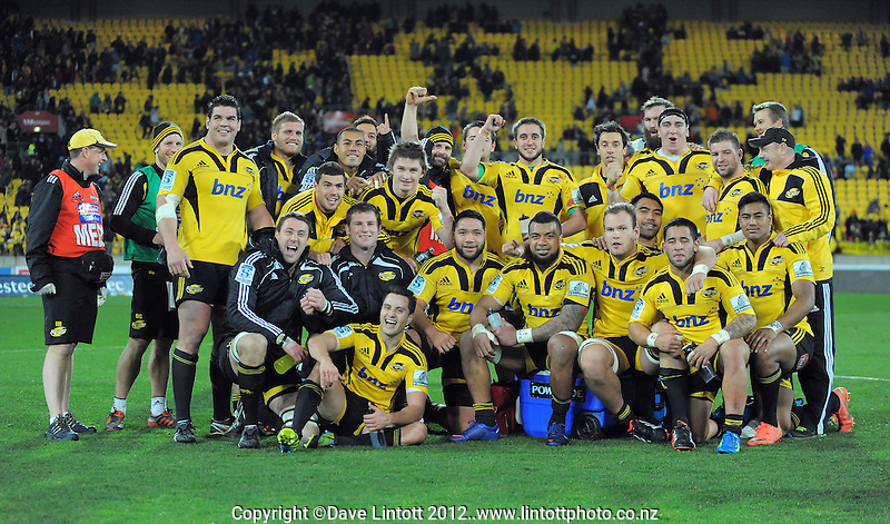 The Hurricanes celebrate victory during the Super 15 rugby match between the Hurricanes and Chiefs at Westpac Stadium, Wellington, New Zealand on Friday, 13 July 2012. Photo: Dave Lintott / lintottphoto.co.nz