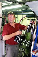 Daniel Le Conte des Floris Domaine Le Conte des Floris, Caux. Pezenas region. Languedoc. Mobile bottling line. Bottling line operator. Owner winemaker. France. Europe. Bottle.