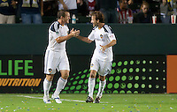CARSON, CA - October 16, 2011: LA Galaxy Chad Barrett (11) celebrates his goal with teammate Mike Magee (18) during the match between LA Galaxy and Chivas USA at the Home Depot Center in Carson, California. Final score LA Galaxy 1, Chivas USA 0.