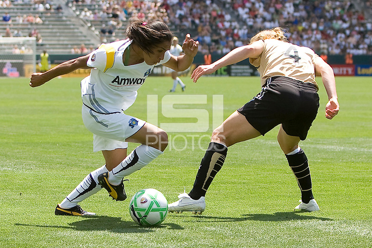 LA Sol's Marta attempts to move past FC Gold Pride's Rachel Buehler. The LA Sol defeated FC Gold Pride of the Bay Area 1-0 at Home Depot Center stadium in Carson, California on Sunday April 19, 2009.  ..  .