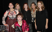 NWA Democrat-Gazette/CARIN SCHOPPMEYER Billie Starr (seated) is joined by family members Shannon Arcana (from left), Renee Starr, Shannon Starr Arcana, Cindy Starr and Rachel Starr Sloan at the grand re-opening gala Nov. 17.