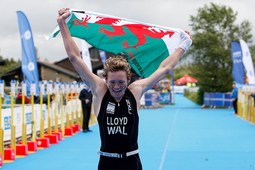 Photo: Richard Lane/Richard Lane Photography. GE Parc Bryn Bach Triathlon. 19/09/2010. Liam Lloyd celebrates as he crosses the line, holding aloft a Wales flag, to win the IRC Youth Men Race.