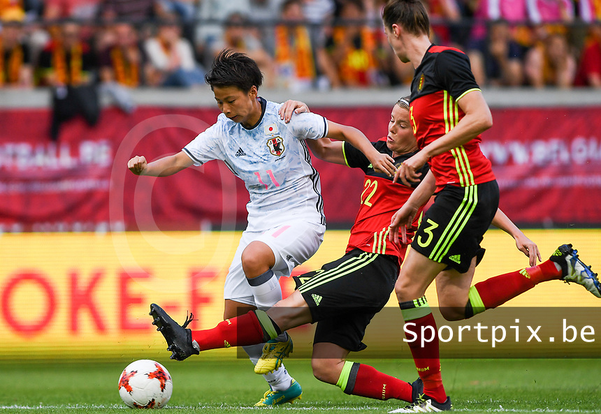 20170613 - LEUVEN ,  BELGIUM : Belgian Laura Deloose (22) pictured tackling Japanese Mina Tanaka (left) during the friendly female soccer game between the Belgian Red Flames and JAPAN , a friendly game in the preparation for the European Championship in The Netherlands 2017  , Tuesday 13 th June 2017 at Stadion Den Dreef  in Leuven , Belgium. PHOTO SPORTPIX.BE | DAVID CATRY