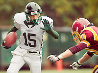 Peninsula wide receiver Charlie Menkens (15) braces for a tackle from O'Dea linebacker Michael Martin (20) at Memorial Stadium in Seattle, Washington, on Saturday, November 6, 2010. O'Dea won the game 21-7.