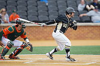 Nate Mondou (10) of the Wake Forest Demon Deacons follows through on his swing against the Miami Hurricanes at Wake Forest Baseball Park on March 22, 2015 in Winston-Salem, North Carolina.  The Demon Deacons defeated the Hurricanes 10-4.  (Brian Westerholt/Four Seam Images)