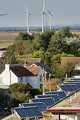 Solar panels on holiday homes next to the Npower Renewables wind farm at Little Cheyne Court,  Camber, Kent.