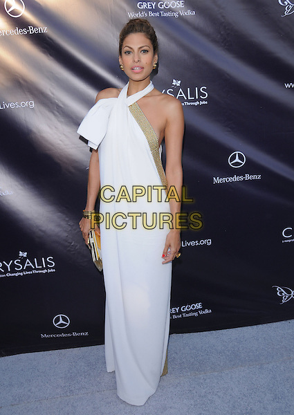 EVA MENDES .at the 9th Annual Chrysalis Butterfly Ball held at  a private residence in Brentwood, California, USA, .June 5th 2010..full length white long maxi halterneck dress gold trim clutch bag bracelets .CAP/RKE/DVS.©DVS/RockinExposures/Capital Pictures.