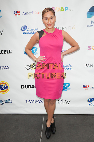 Adrienne Bailon <br /> attends the 'Swim for Relief' Benefiting Hurricane Sandy Recovery at Herald Square, New York City, NY., USA.<br /> October 9th, 2013 <br /> full length dress hand on hip pink<br /> CAP/MPI/COR<br /> &copy;Corredor99/ MediaPunch/Capital Pictures