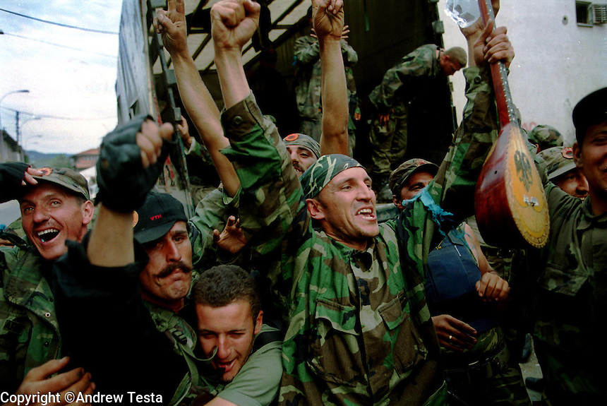 KLA fighters from the Atlantic Brigade celebrate their arrival in Pristina after leaving the front lines on the Pastrik mountain near Albania, which saw some of the heaviest fighting between Serbs and KLA..Kosovo, 17/06/99.