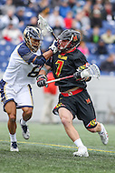 Annapolis, MD - February 11, 2017: Maryland Terrapins Tim Rotanz (7) is being defended by Navy Midshipmen Greyson Torain (6) during game between Maryland vs Navy at  Navy-Marine Corps Memorial Stadium in Annapolis, MD.   (Photo by Elliott Brown/Media Images International)