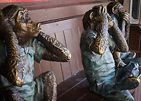 Three bronze monkeys in classic poses on a bench in front a tavern on State Street in Madison.