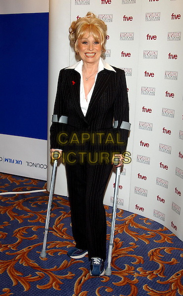 BARBARA WINDSOR.Women in Film and Television Awards.Hilton Hotel.05 December 2003.full length, full-length, crutches, broken, injury, foot, leg, ankle ?.©Capital Pictures.sales@capitalpictures.com.www.capitalpictures.com.©Capital Pictures