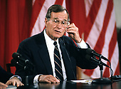 United States President George H.W. Bush adjusts his earpiece as he makes remarks during a joint press conference with President Mikhail Gorbachev of the Union of Soviet Socialist Republics, at the conclusion of their summit in the East Room of the White House in Washington, DC on Sunday, June 3, 1990.  <br /> Credit: Ron Sachs / CNP