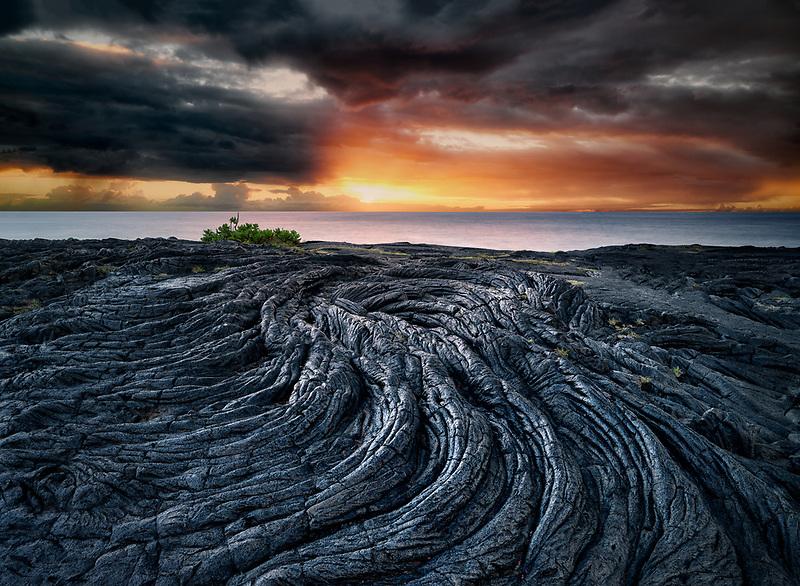 Pahoehoe lava flow, sunrise and ocean. The Puna Coast, Hawaii.