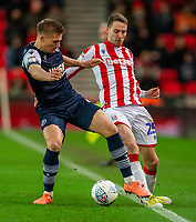 11th January 2020; Bet365 Stadium, Stoke, Staffordshire, England; English Championship Football, Stoke City versus Milwall FC; Shaun Hutchinson of Millwall tackles Nick Powell of Stoke City - Strictly Editorial Use Only. No use with unauthorized audio, video, data, fixture lists, club/league logos or 'live' services. Online in-match use limited to 120 images, no video emulation. No use in betting, games or single club/league/player publications