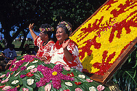 women riding float in Aloha Festivals parade, Honolulu