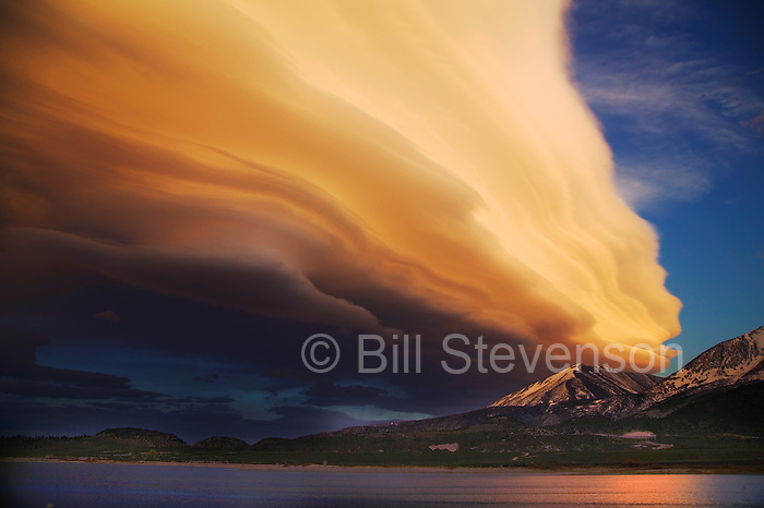 A lenticular cloud at sunset over Crowley Lake, CA and the Sierra mountains.