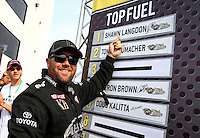Aug. 18, 2013; Brainerd, MN, USA: NHRA top fuel dragster driver Shawn Langdon after clinching his spot in the playoffs during the Lucas Oil Nationals at Brainerd International Raceway. Mandatory Credit: Mark J. Rebilas-