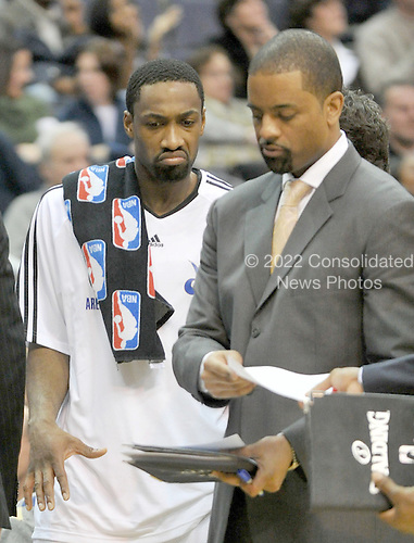 Washington, DC - January 2, 2010 -- Washington Wizards guard Gilbert Arenas (0), left, and assistant coach Wes Unseld, Jr. during a break in the action in the fourth quarter against the San Antonio Spurs at the Verizon Center in Washington, D.C. on Saturday, January 2, 2010.  The Spurs won the game 97 - 86..Credit: Ron Sachs / CNP..(RESTRICTION: NO New York or New Jersey Newspapers or newspapers within a 75 mile radius of New York City)