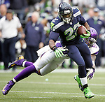 Seattle Seahawks running back Robert Turbin runs through the attempted tackle by Minnesota Vikings linebacker Jasper Brinkley at CenturyLink Field in Seattle, Washington on  November 4, 2012.  Seahawks beat the Vikings 30-20.     ©2012. Jim Bryant Photo. All Rights Reserved.