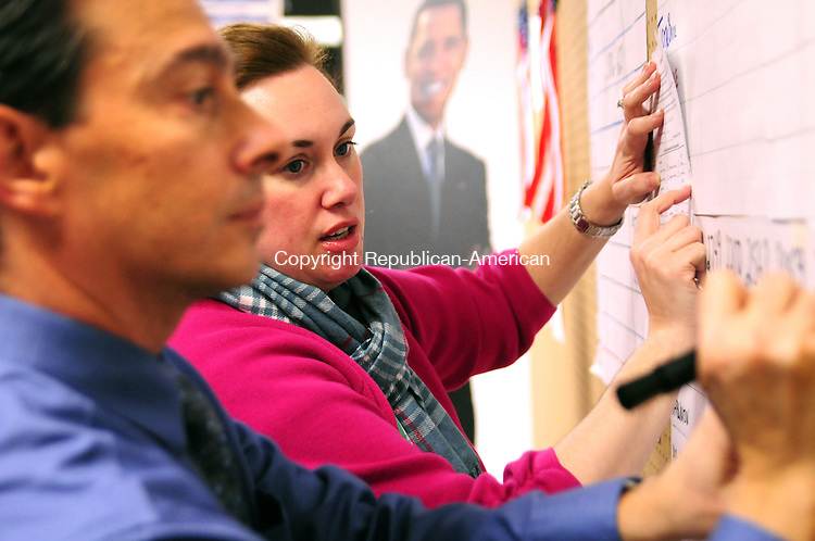 BRISTOL, CT, 06 NOV 12-11062AJ01- Deane Kilbourne, chairman of the Bristol Democratic Town Committee and Karen Matthews post election results on a scoreboard Tuesday at the Democratic headquarters in Bristol.  Alec Johnson/ Republican-American