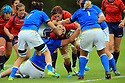 BELFAST, NORTHERN IRELAND - AUGUST 26: Spain's Berta Garcia is stopped by Italy's Isabel Rico and Paula Medin during a final play off  in the Women's World Cup Rugby 2017 at Queen's  University Belfast, Saturday,  August 26, 2017. Photo/Paul McErlane