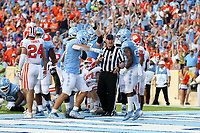 CHAPEL HILL, NC - SEPTEMBER 28: Javonte Williams #25 of the University of North Carolina celebrates his touchdown with Jake Bargas #80 during a game between Clemson University and University of North Carolina at Kenan Memorial Stadium on September 28, 2019 in Chapel Hill, North Carolina.